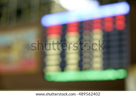 Abstract background of flight schedule information board in blur with copy space for use