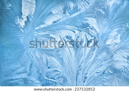 Abstract background of frost water on cold window glass - stock photo