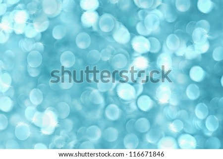 Abstract background of icy blue holiday lights - stock photo