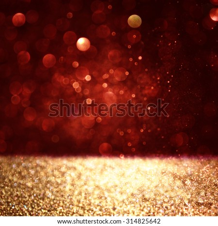 abstract background of red and gold glitter bokeh lights, defocused - stock photo
