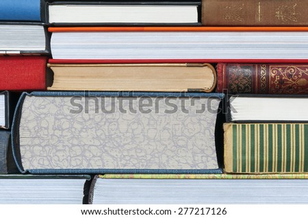 Abstract background of stacked books. - stock photo