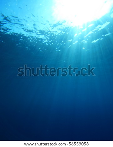 Abstract background of sunburst in ocean - stock photo
