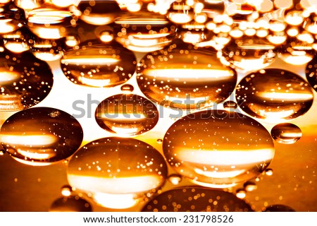 Abstract background of the oil droplets on the water. - stock photo