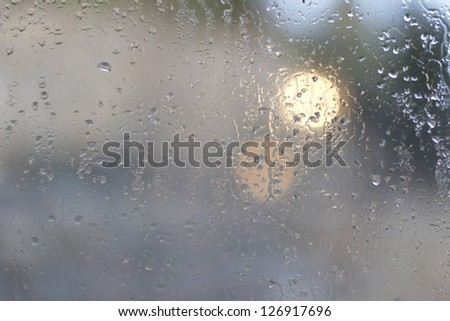 Abstract background of water drops on window glass - stock photo