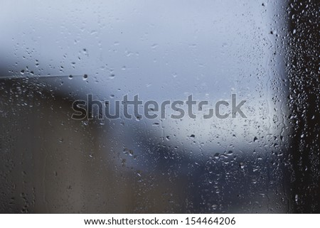 Abstract background of water drops on window glass