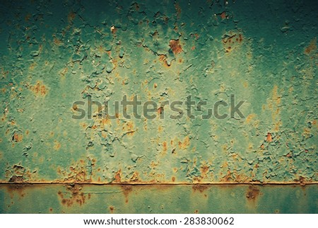 Abstract background - old metal surface with a shabby paint.