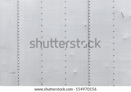 Abstract background photo texture of gray metal wall with rivets - stock photo