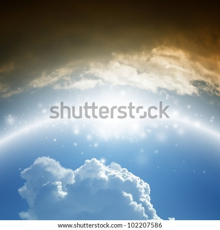 Abstract background - shining rainbow in blue sky with white and dark clouds - heaven and hell - stock photo