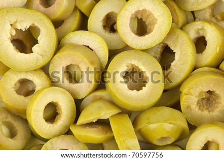 Abstract background: sliced green olives - stock photo