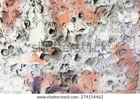Abstract background stone wall texture in ethnic style with seashell or gravel traces as a retro pattern layout. - stock photo