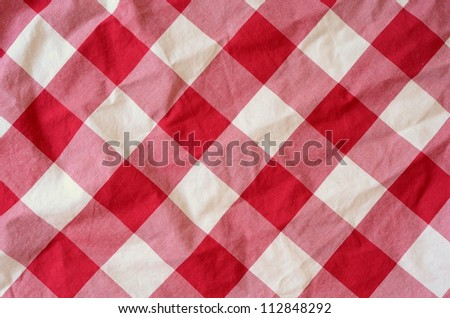 Abstract Background Texture Of A Red And White Checkered Picnic Blanket - stock photo
