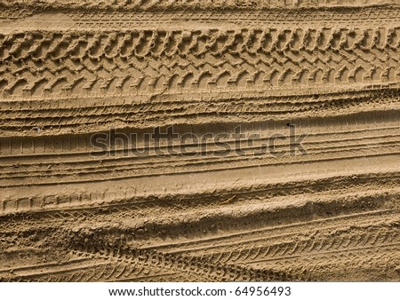 Abstract background - the wheel tracks in the sand. - stock photo