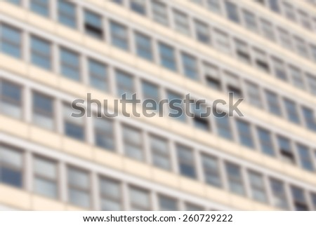 Abstract background -   windows of a modern building in a row, view from below - blur effect defocusing filter applied - stock photo