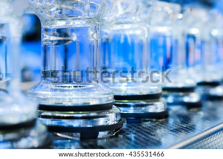 Abstract background with blue glass tubes. Detail of a Soxhlet extractor. Chemical laboratory equipment. - stock photo
