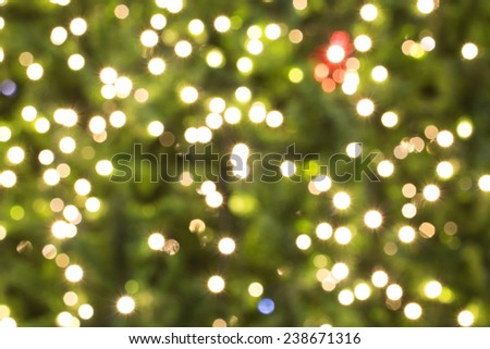 Abstract background with bokeh defocused colorful lights - image of defocused lights on the Christmas tree - stock photo