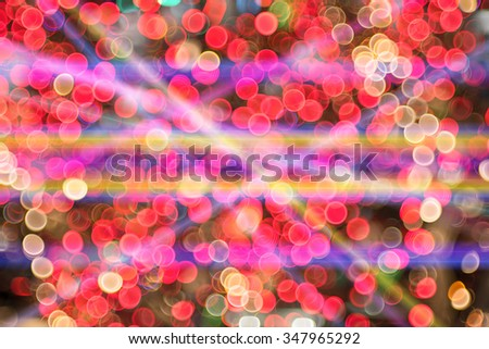 abstract background with bokeh lights and laser beam.