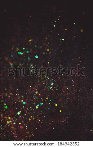 Abstract background with glittering color particles - stock photo