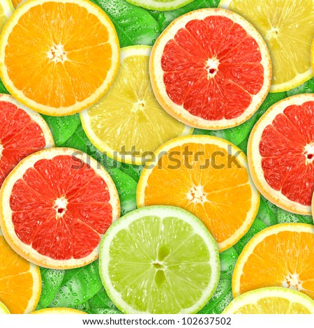 Abstract background with motley citrus-fruit slices and green leaf with dew. Seamless pattern for your design. Close-up. Studio photography. - stock photo