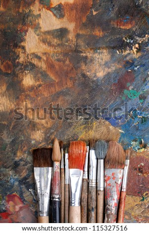 Abstract background with paint brushes - stock photo