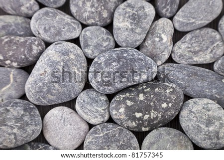 Abstract background with round pebble stones, found on a beach on the Island of Corsica, Europe - stock photo