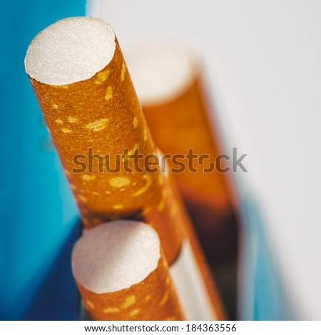 Abstract backgrounds with few cigarettes into the box - stock photo