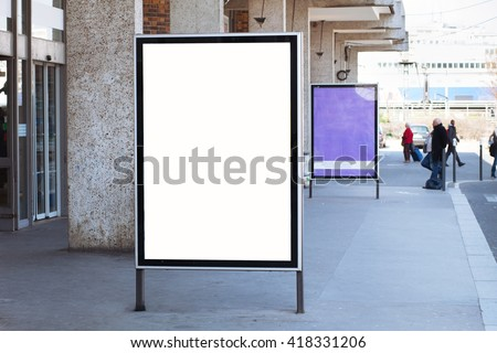 abstract billboard on the street with white blank screen with place for text - stock photo