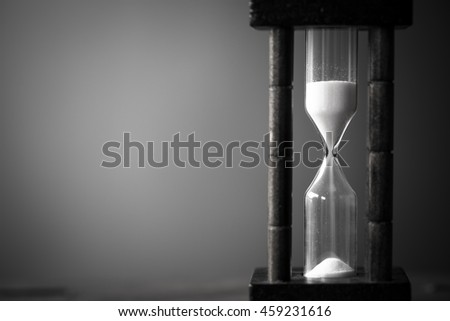 Abstract Black and White hourglass. passing time in a countdown sandglass with copy space for add text.