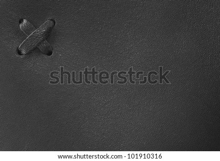 Abstract black leather background with cross - stock photo