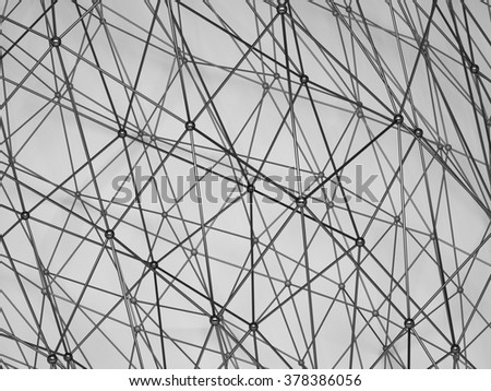 Abstract black shining 3d digital molecular mesh structure over gray background with soft shadows. Digital illustration