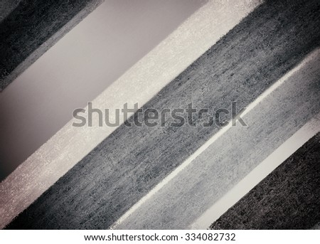 abstract black white and gray striped background, large and small striped lines in diagonal slanted pattern - stock photo