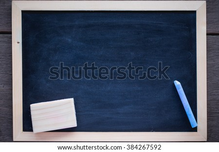 Abstract blank school black board is isolated on a white background. Empty blank black chalkboard with chalk traces