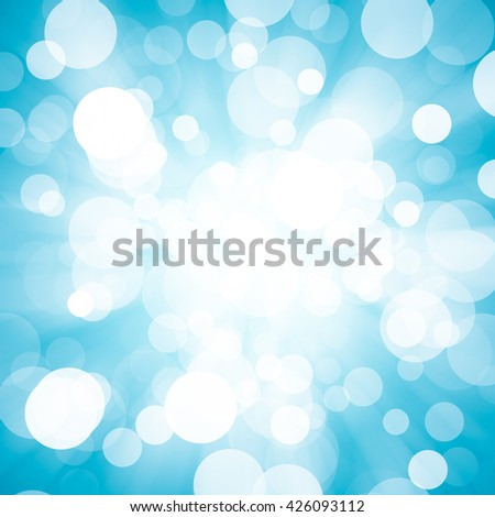 abstract blue background. bokeh abstract light background. light background with a magnificent sun burst with lens flare. blue blurred background / Christmas background. - stock photo