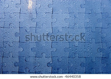 Abstract blue background (raindrops on blue glass as a jigsaw puzzle) - stock photo