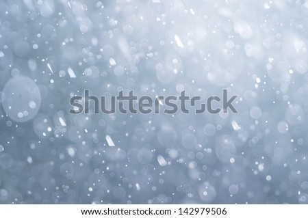 abstract blue bokeh defocused background, falling water drops, rain
