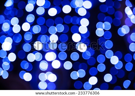 Abstract blue circular bokeh background against dark background for use at graphic design - stock photo