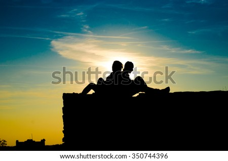 abstract blue clouds and sunset background silhouette of men and women, horizontal photo