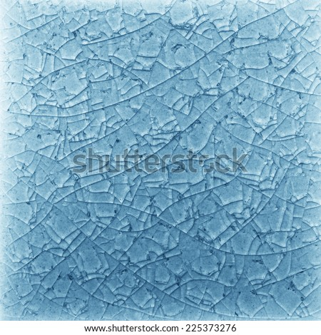 Abstract, Blue cracked glass background - stock photo
