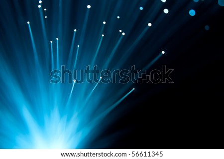 Abstract blue fibre optic strands. - stock photo