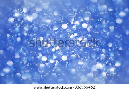 Abstract blue glitter background. Shiny glitter bokeh christmas background. - stock photo