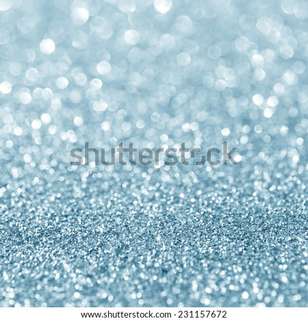 Abstract blue glitter holiday background - stock photo