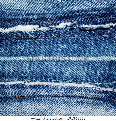 abstract blue jeans background stitching and tearing texture - stock photo