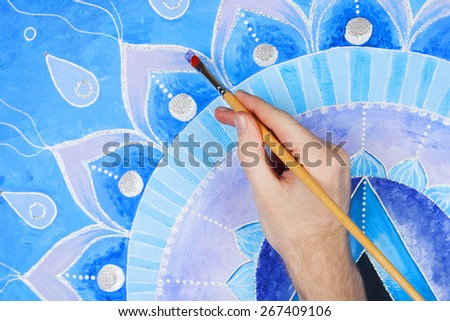 abstract blue painted picture with circle pattern, mandala of Vi - stock photo