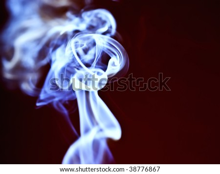 Abstract blue smoke against a dark background