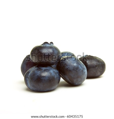 Abstract blueberries from low perspective isolated on white. - stock photo