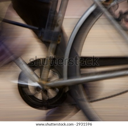 Abstract blur background of bicycle pedal, chain and rear wheel in motion - stock photo