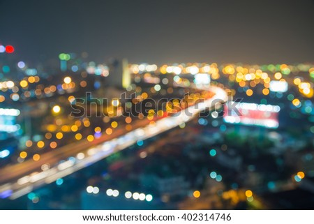 Abstract Blur Background of City with Highway and Bokeh Light - stock photo
