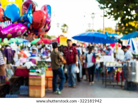 abstract blur background of people shopping at market fair - stock photo