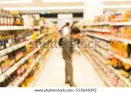 abstract Blur Background, People Shopping for Grocery in Supermarket or Hypermarket with Goods on Shelves.