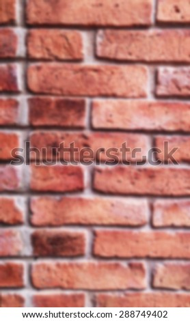 Abstract blur Background red brick wall  - stock photo