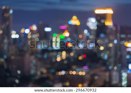 Abstract blur bokeh light of city downtown at night - stock photo